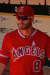 OAKLAND, CA - JUNE 21:  Taylor Featherston #8 of the Los Angeles Angels of Anaheim stands in the dugout before the game against the Oakland Athletics at O.co Coliseum on June 21, 2015 in Oakland, California. The Oakland Athletics defeated the Los Angeles Angels of Anaheim 3-2. (Photo by Jason O. Watson/Getty Images) *** Local Caption *** Taylor Featherston