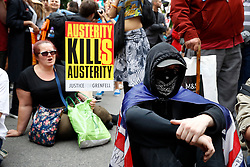 © Licensed to London News Pictures. 01/07/2017. London, UK. Protestors sit down outside Downing Street during the People's Assembly anti-austerity demonstration. Speakers include Labour Party Leader Jeremy Corbyn. Photo credit: Peter Macdiarmid/LNP