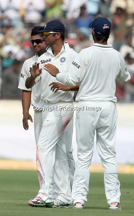 Indian bowler Suresh Raina celebrates with Rahul Dravid and C. Pujara New Zealand batsman Daniel Vettori wicket during the Indian vs New Zealand 2nd test match day-5 Played at Rajiv Gandhi International Stadium, Uppal, Hyderabad 16 November 2010 (5-day match)