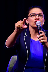 Rep. Rashida Tlaib (D-MI) speaks on the current political climate and possible impeachment of the current President during a panel discussion led by Aimee Allison, touching the changes of the face of power in the United States after a history making number of diverse members were sworn into Congress the past elections, during a keynote discussion of the Netroots Nation progressive grassroots convention in Philadelphia, PA, on July 13, 2019.