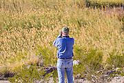 Birdwatcher, binoculars, Big Bend National Park, Texas, winter.