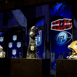 Feb 05, 2010;  Fort Lauderdale, FL, USA; New Orleans Saints (left) and Indianapolis Colts (right) team helmets on display with the Vince Lombardi Trophy during press conferences held at the Super Bowl XLIV media center at the Fort Lauderdale/Broward County Convention Center. Mandatory Credit: Derick E. Hingle