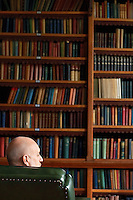 Businessman Sitting in Library