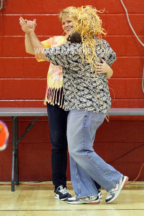 Middletown, New York  - Dancing in the gymnasium during the Middletown YMCA Family Fall Festival on Oct. 29, 2011.