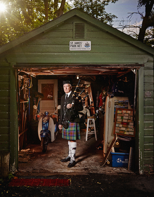 Bagpiper in his full piping garb posed outside of his personal Shed Shot on a PhaseOne IQ180 as a Environmental Portrait.