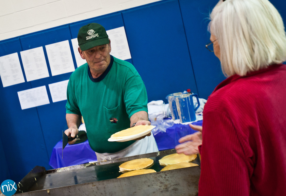 Volunteer Buddy Deal serves pancakes during pancake day, the annual fundraiser for the Cabarrus County Boys & Girls Club. (Photo by James Nix)