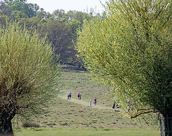 © Licensed to London News Pictures. 11/04/2020. London, UK. People exercing in Richmond Park. Londoners have been told to stay at home and only leave homes to exercise or when absolutely essential in an attempt to fight the spread of COVID-19 as temperatures for the Easter Bank holiday weekend are expected to reach 26c. Photo credit: Alex Lentati/LNP