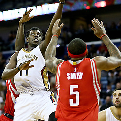 Jan 25, 2016; New Orleans, LA, USA; New Orleans Pelicans guard Jrue Holiday (11) shoots over Houston Rockets center Josh Smith (5) during the second half of a game at the Smoothie King Center. The Rockets defeated the Pelicans 112-111. Mandatory Credit: Derick E. Hingle-USA TODAY Sports