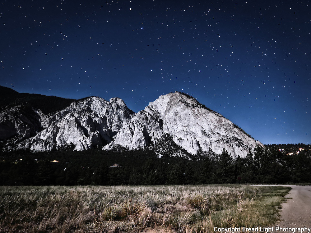 Taken from a camp on the Mt. Antero side of the valley dividing the two peaks.  The limestone cliffs at the base of Mt. Princeton glow in the moonlight as a full sky of stars spins above.