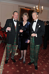 Left to right, HAMISH McFALL and COLONEL & MRS JOHN ROSS at a dinner in aid of Caring For Courage - The Royal Scots Dragoon Guards Afghanistan Welfare Appeal held at The Royal Hospital Chelsea, London SW3 on 20th October 2011.