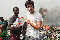 Christopher, 15 wtih Zayn Nalik from One Direction on a tip in Agbogbloshie slum, Accra