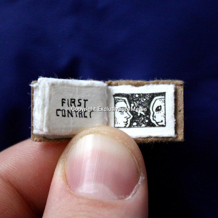 """The Mini Book of Major Events', A Tiny Book Mapping World History<br /> <br /> Created by Denver illustrator Evan Lorenzen, The Mini Book of Major Events is a finger-sized picture book that attempts to distill the major events of the world's history into a few key pages. On the first page """"life arises"""" and by the end, it's """"first contact,"""" with """"extinction,"""" """"agriculture"""" and more filling the pages between.<br /> ©Evan Lorenzen/Exclusivepix Media"""