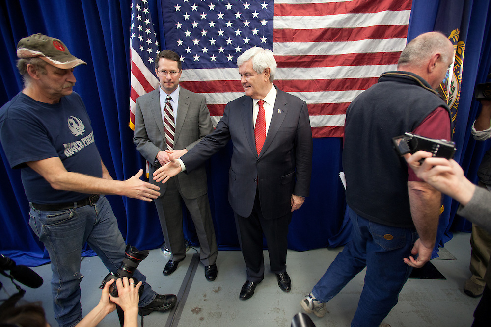 NEWPORT, NH - JANUARY 06:  Republican presidential candidate and former House Speaker Newt Gingrich shakes hands with an employee at the Ruger Firearms manufacturing facility during a campaign stop in Newport, New Hampshire on January 06, 2012. After finishing 4th in the Iowa Caucus, Gingrich continued his campaign in New Hampshire for the upcoming primary. (Photo by Matthew Cavanaugh/Getty Images)
