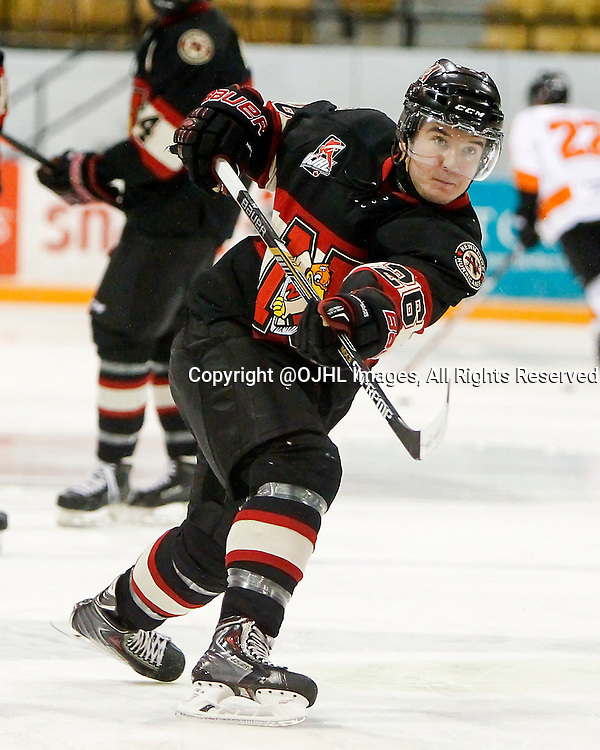NEWMARKET, ON - Oct 8, 2015 : Ontario Junior Hockey League game action between Orangeville and Newmarket, Marty Lawlor #26 shoots the puck during warm-up.<br /> (Photo by Brian Watts / OJHL Images)