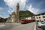 Bernina Express arriving at Tirano, passing church square.