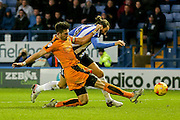 Wolverhampton Wanderers defender Danny Batth tackles Sheffield Wednesday striker Atdhe Nuhiu  during the Sky Bet Championship match between Sheffield Wednesday and Wolverhampton Wanderers at Hillsborough, Sheffield, England on 20 December 2015. Photo by Simon Davies.