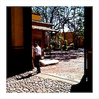 A security guard opens the front gate to the Herradura tequila distillery in Tequila, Jalisco, Mexico. (iPhone image) --- Image created for http://tastetequila.com