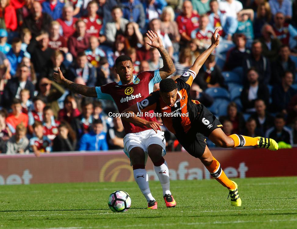 10.09.2016. Turf Moor, Burnley, England. Premier League Football. Burnley versus Hull City.  Burnley striker Andre Gray challenges Hull City defender Curtis Davies.