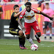 HARRISON, NEW JERSEY- OCTOBER 16:  Kemar Lawrence #92 of New York Red Bulls is challenged by Cristian Martinez #18 of Columbus Crew during the New York Red Bulls Vs Columbus Crew SC MLS regular season match at Red Bull Arena, on October 16, 2016 in Harrison, New Jersey. (Photo by Tim Clayton/Corbis via Getty Images)