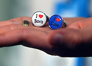 """© Licensed to London News Pictures. 03/10/2012. Birmingham, UK A stall holder holds up a pair of cufflinks which say """"I love Boris"""" and """"I love Dave"""" on Day 1 at The Conservative Party Conference at the ICC today 7th October 2012. Photo credit : Stephen Simpson/LNP"""