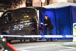 © Licensed to London News Pictures. 18/01/2018. London, UK. An a private ambulance removes the body at the scene in Knightsbridge, London, where a woman died after being hit by a lorry on Brompton Road  shortly before 6pm between the Victoria and Albert Museum and Harrods. Photo credit: Guilhem Baker/LNP