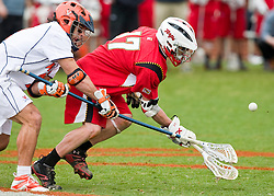 Virginia Cavaliers D Chad Gaudet (7) and Maryland Terrapins SSM Bryn Holmes (17) battle for a faceoff.  The #9 ranked Maryland Terrapins fell to the #1 ranked Virginia Cavaliers 10 in 7 overtimes in Men's NCAA Lacrosse at Klockner Stadium on the Grounds of the University of Virginia in Charlottesville, VA on March 28, 2009.