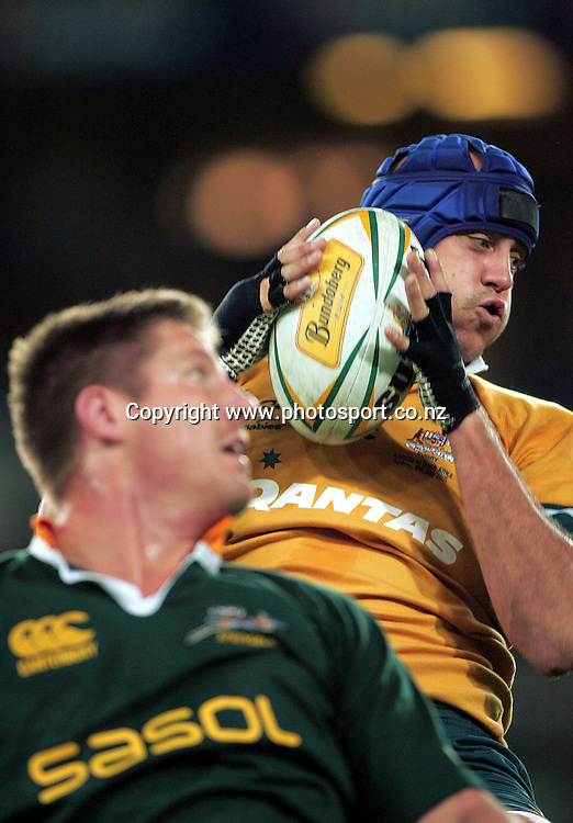 Nathan Sharpe wins the lineout over Bakkies Botha during the Test Match for the Nelson Mandela Challenge Plate between Australia v South Africa at Telstra Stadium, Sydney on 9 July 2005. Wallabies won the game 30-12. Photo: Paul Seiser ©Seiser Photography/PHOTOSPORT