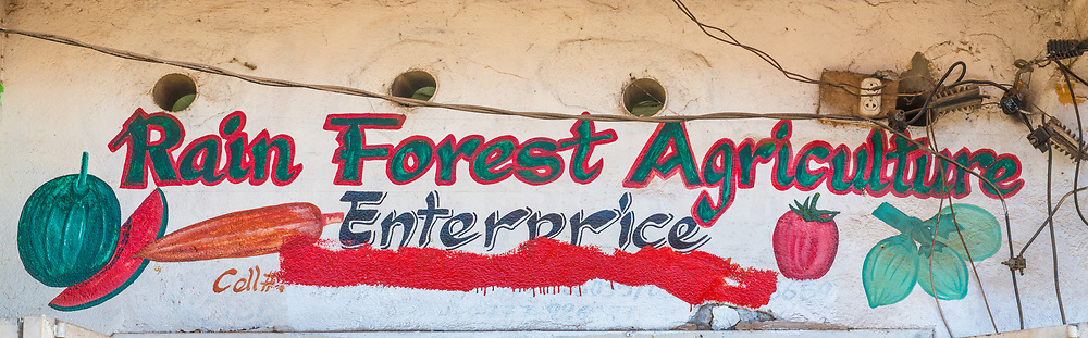 "A sign reads ""Rain Forest Agriculture"" in Ganta, Liberia"