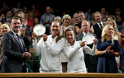 Ladies Doubles runners up Nicole Melichar and Kveta Peschke (right) on day twelve of the Wimbledon Championships at the All England Lawn Tennis and Croquet Club, Wimbledon. PRESS ASSOCIATION Photo. Picture date: Saturday July 14, 2018. See PA story TENNIS Wimbledon. Photo credit should read: Jonathan Brady/PA Wire. RESTRICTIONS: Editorial use only. No commercial use without prior written consent of the AELTC. Still image use only - no moving images to emulate broadcast. No superimposing or removal of sponsor/ad logos. Call +44 (0)1158 447447 for further information.