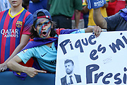 Barcelona Gerard Pique with banner fans during the International Champions Cup match between Barcelona and Manchester United at FedEx Field, Landover, United States on 26 July 2017.