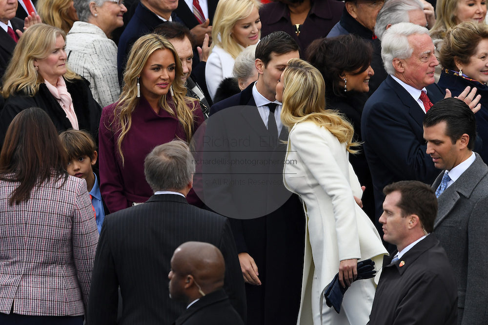 Ivanka Trump gives her husband Jared Kushner a kiss as she arrives for the President Inaugural Ceremony on Capitol Hill January 20, 2017 in Washington, DC. Donald Trump became the 45th President of the United States in the ceremony.