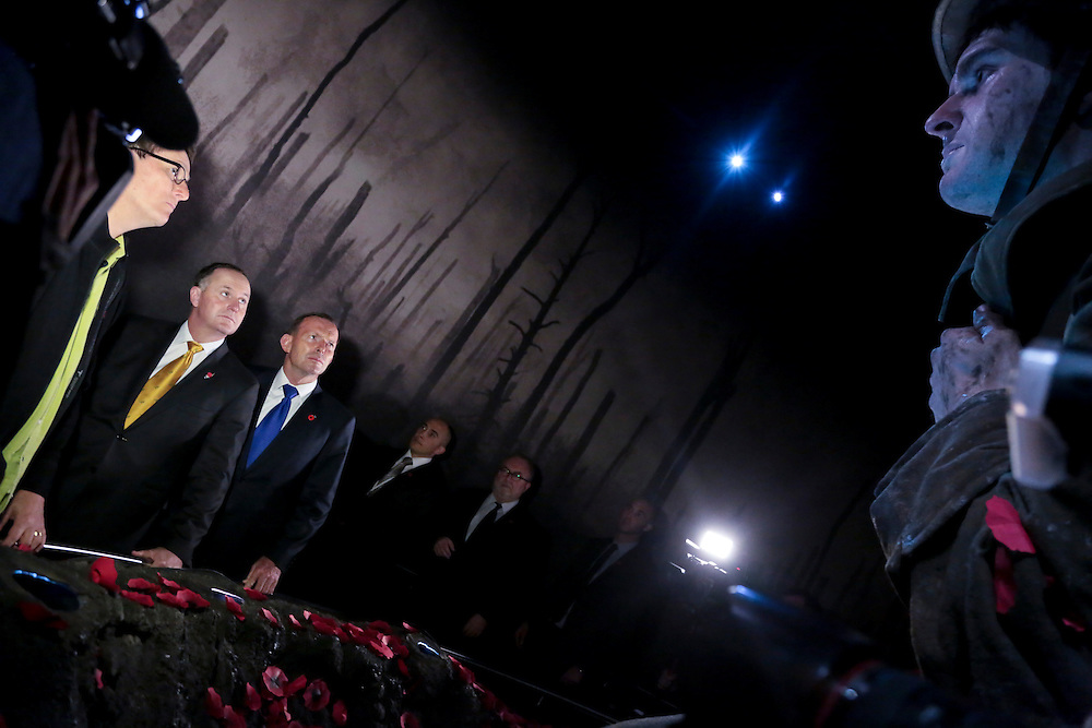 New Zealand Prime Minister John Key, left and Australian Prime Minister Tony Abbott view The Scale of Our War exhibition, at the Te Papa Museum, Wellington, New Zealand, Monday, April 20, 2015. Credit:SNPA / POOL