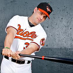 February 26, 2011; Sarasota, FL, USA; Baltimore Orioles left fielder Luke Scott (30) poses during photo day at Ed Smith Stadium.  Mandatory Credit: Derick E. Hingle