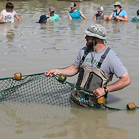 Jimmy Young keeps the net moving to help students from Mooreville and Saltillo High Schools harvest catfish Thursday as part of their agriculture class.