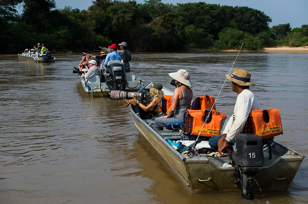 Tourists watching jaguar<br /> Northern Pantanal<br /> Mato Grosso<br /> Brazil