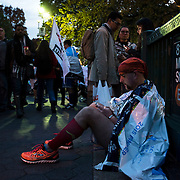 November 1, 2015 - New York, NY : A runner checks his phone as he sits outside the West 81st Street B/C Subway station after completing the 2015 TCS New York City marathon on Sunday.<br />  CREDIT: Karsten Moran for The New York TImes