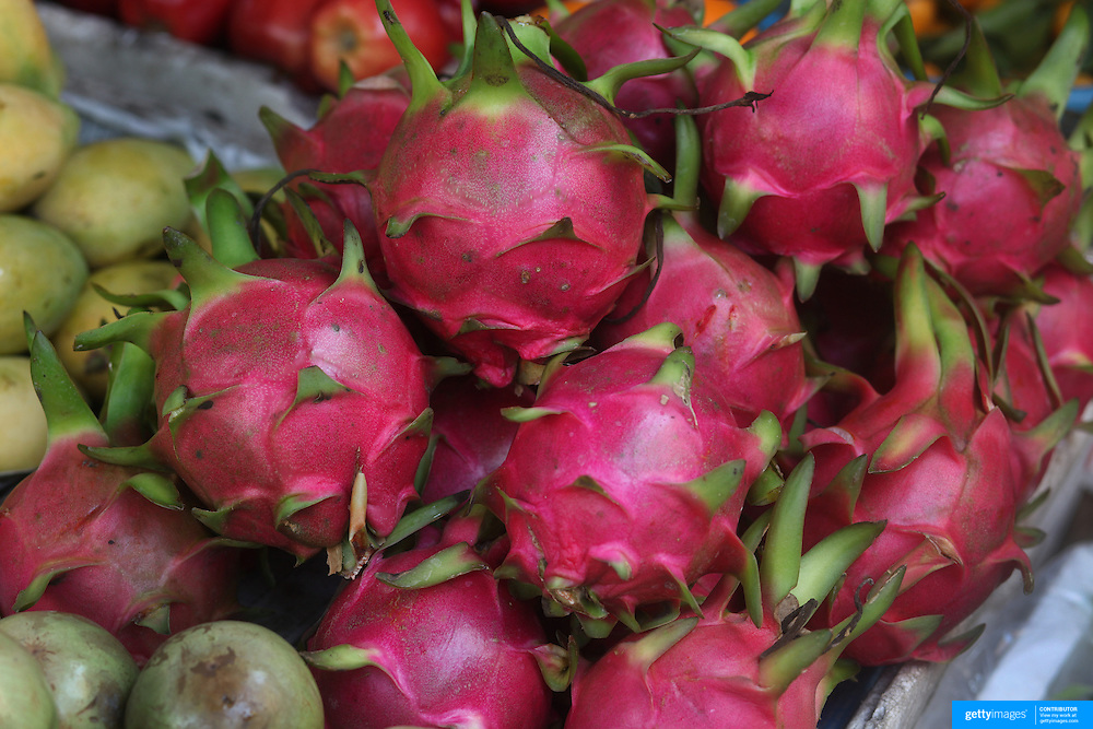 Dragon fruit for sale at the market in Hoi An, Vietnam. Hoi An is an ancient town and an exceptionally well-preserved example of a South-East Asian trading port dating from the 15th century. Hoi An is now a major tourist attraction because of its history. Hoi An, Vietnam. 5th March 2012. Photo Tim Clayton
