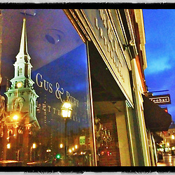 """The North Church reflected in a store window on Congress Street in Portsmouth, New Hampshire. iPhone photo - suitable for print reproduction up to 8"""" x 12""""."""