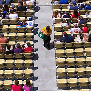 Food vendors work a mostly empty Dodger Stadium during a recent game against the league leading Philadelphia Phillies. Dodger attendance is way down for the year.