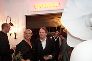 AMANDA ELIASCH; TIM WILLIS, Party at the home of Amanda Eliasch in Chelsea after the opening of As I Like it. A memory by Amanda Eliasch and Lyall Watson. Chelsea Theatre. Worl's End. London. 4 July 2010<br /> <br />  , -DO NOT ARCHIVE-© Copyright Photograph by Dafydd Jones. 248 Clapham Rd. London SW9 0PZ. Tel 0207 820 0771. www.dafjones.com.