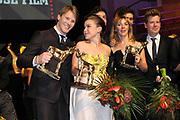 NFF - Nederlands Filmfestival - uitreiking van de Gouden Kalveren in Tivolli Utrecht.<br /> <br /> op de foto:  Winnaar Beste Acteur Gijs Naber voor zijn rol in de film Aanmodderfakker, Beste Actrice Abbey Hoes voor haar rol in Nena en Beste Film Aanmodderfakker Iris Otten