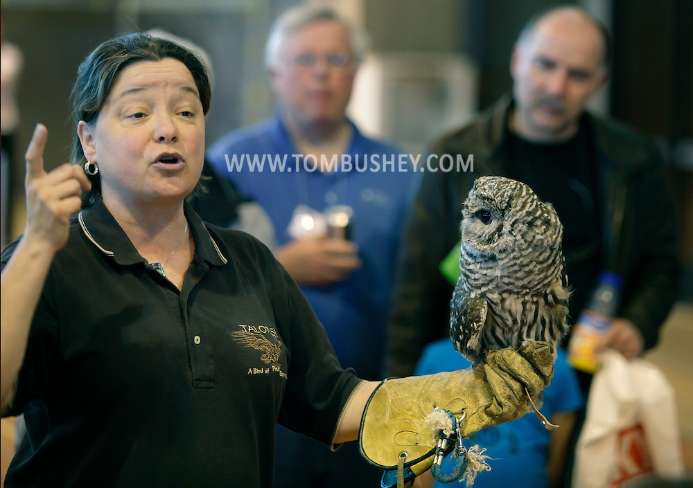 """Suffern, New York - Lorrie Schumacher holds an owl during a presentation at the """"Talons! A Birds of Prey Experience"""" exhibit at the Northeast Astronomy Forum at Rockland Community College on April 17, 2011."""