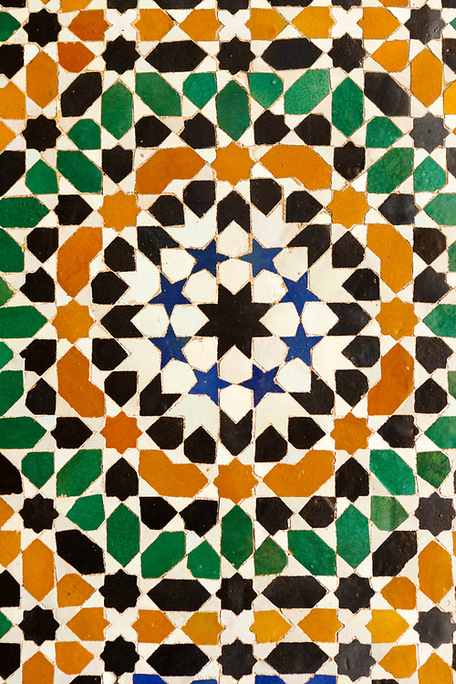 """Moroccan zelij mosaic wall / doorway tiling, Bahia Palace, Marrakesh, Morocco, 2016–04-21.<br /><br />The name Bahia means """"brilliance"""" and the Bahia palace was built with the intention of being the most brilliant palace of its time. Built by two different generations - Si Moussa and his son, the layout and overall design is slightly random and unorganised. The materials used to make the intricate displays of zelij, ceramic and wood work through out the palace were sourced from across the Maghreb."""