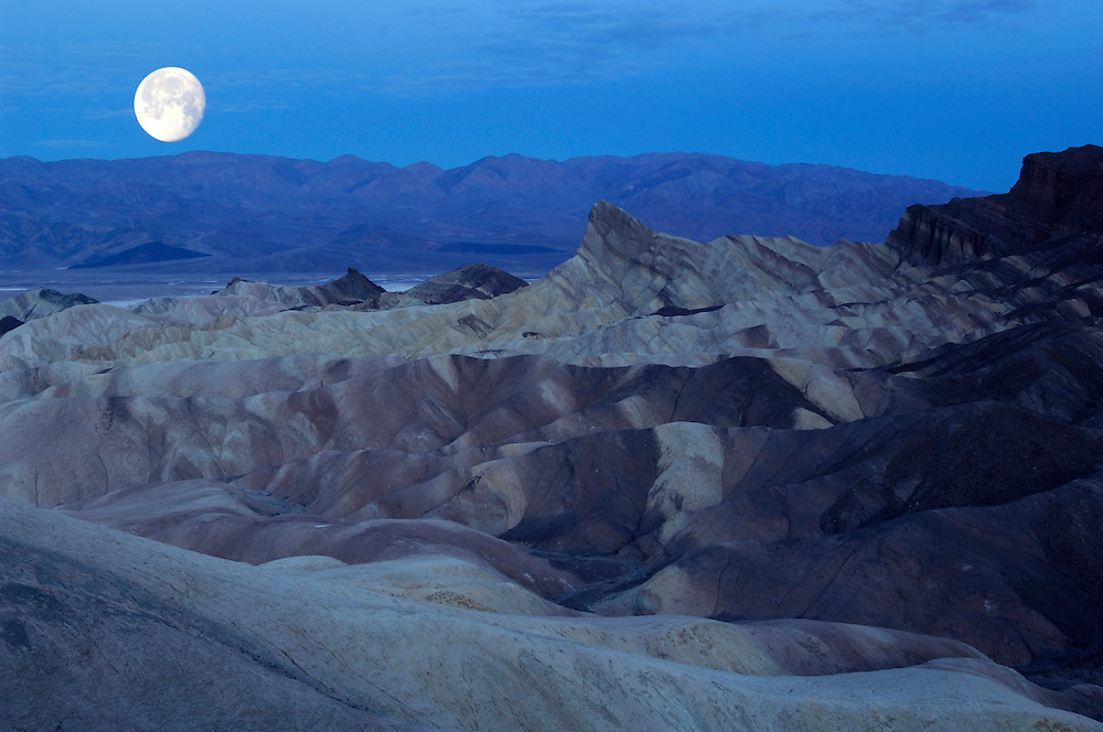 Full moon setting over Valley, view from Zabriskie Point, Death Valley National Park, California, United States of America