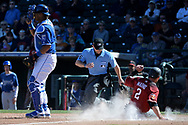 SURPRISE, AZ - MARCH 06:  Jeff Mathis #2 of the Arizona Diamondbacks safely slides into home plate behind Salvador Perez #13 of the Kansas City Royals in the sixth inning in the spring training game at Surprise Stadium on March 6, 2017 in Surprise, Arizona.  (Photo by Jennifer Stewart/Getty Images)