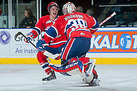 KELOWNA, CANADA -JANUARY 29: Jeremy McIntosh D #4 of the Spokane Chiefs celebrates the win with goaltender Garret Hughson #30 against the Kelowna Rockets on January 29, 2014 at Prospera Place in Kelowna, British Columbia, Canada.   (Photo by Marissa Baecker/Getty Images)  *** Local Caption *** Jeremy McIntosh; Garret Hughson;