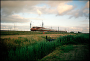 Thalys train running through Dutch landscape, Het Groene Hart, South Holland province.