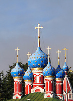 """The colorful onion domes of the church of Saint Dimitry on the Blood, built in 1690, in Uglich, Russia. One of Russia's """"Golden Ring"""" cities, Uglich is one of the country's most culturally significant towns. The once-fortified """"kremlin"""" in which the church stands looks over the Volga River."""