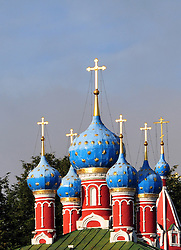 "The colorful onion domes of the church of Saint Dimitry on the Blood, built in 1690, in Uglich, Russia. One of Russia's ""Golden Ring"" cities, Uglich is one of the country's most culturally significant towns. The once-fortified ""kremlin"" in which the church stands looks over the Volga River."
