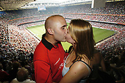 Crowd for Wales v England Rugby at the Millenium Stadium, August 23 2003. Vicky Gilbert, 21, who proposed to Mark Joseph, 27, at half-time.